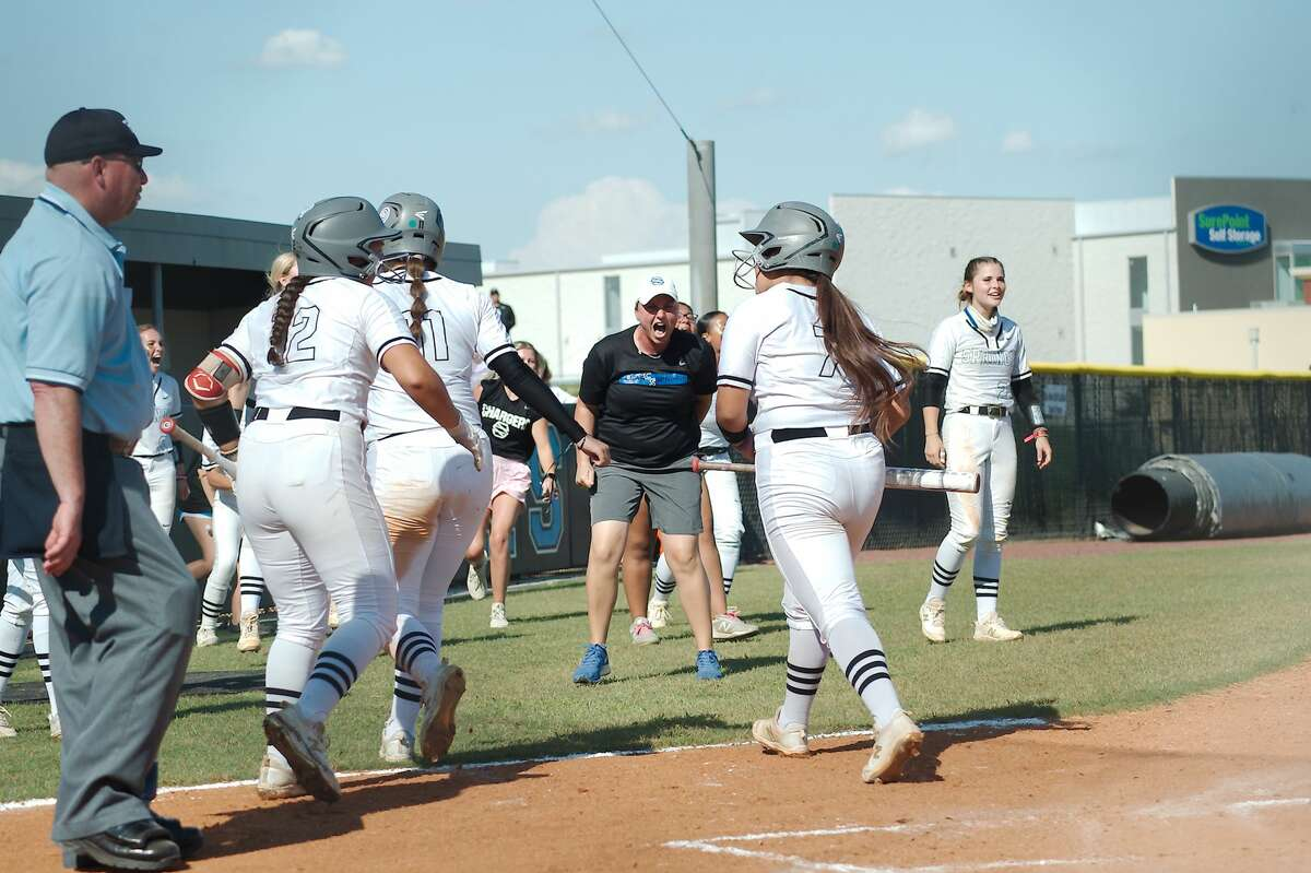 Clear Springs softball coach Jennifer Knight and the LAdy Chargers celebrate runs scored against Deer Park Saturday, May 29 at Shadow Creek High School.