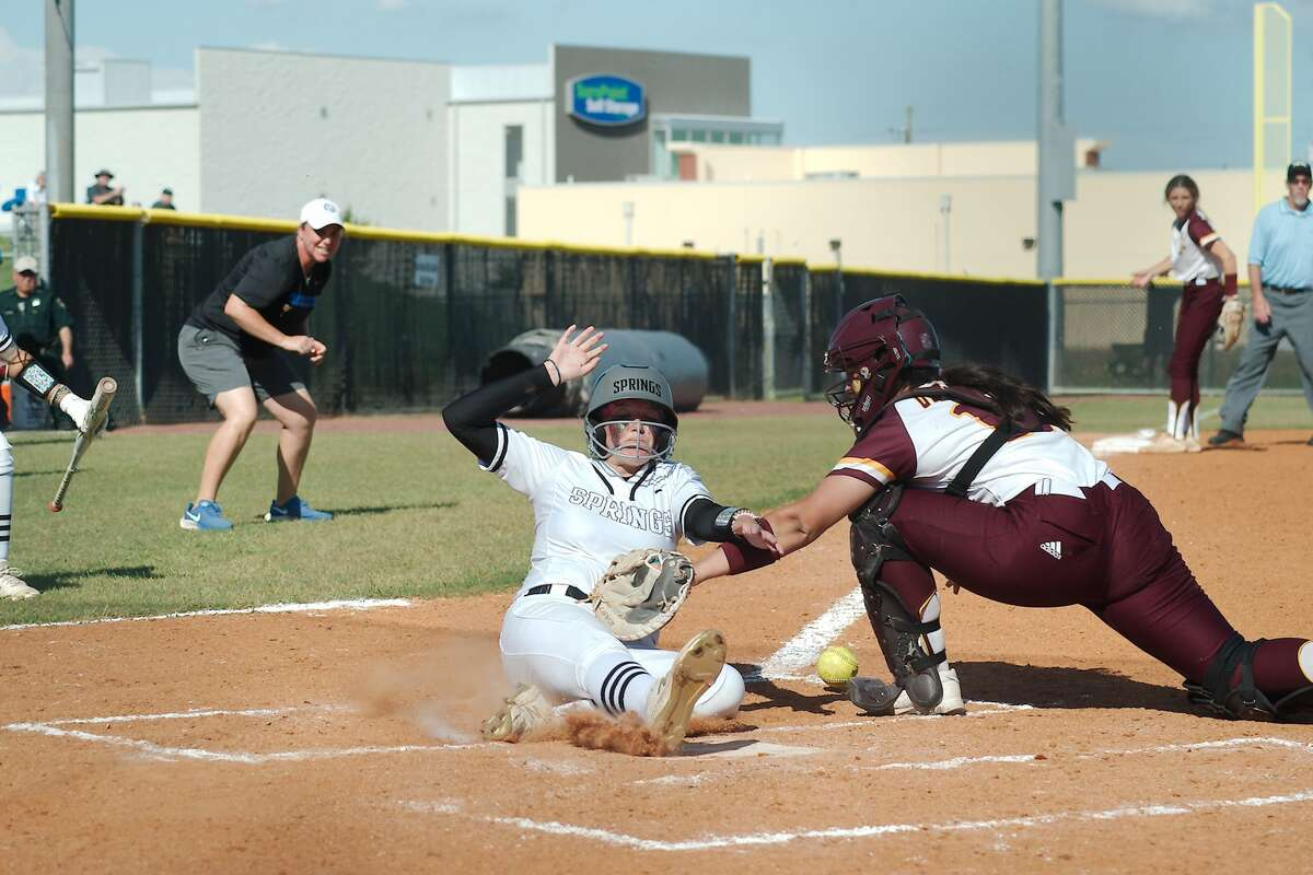 Deer Park?•s Erin Perez (17) loses the ball as Clear Springs?• Lilly Hardy (11) crosses home plate to score the go-ahead run against Deer Park Saturday, May 29 at Shadow Creek High School.