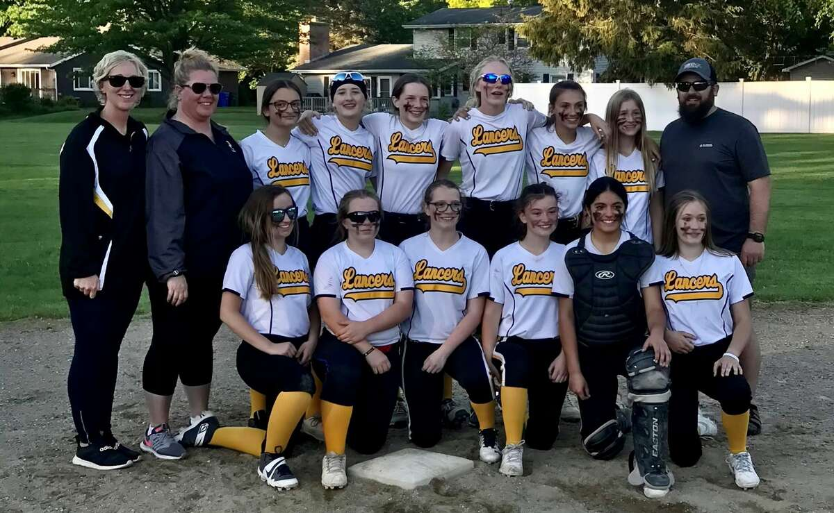 Members of Bullock Creek Middle School's softball team are (back, from left) coach Sara Swift, coach Katie Bass, Ella Ream, Ella Stoney, Charlie Bass, Dakota Swift, Delaney Violette, Bryanna Herron, coach Tom Stoney; and (front, from left) Kaylee Legner, Lily Spann, McKenzie Longstreth, Maybel Schroeder, Jeniffer Young, and Raelynn Avery.