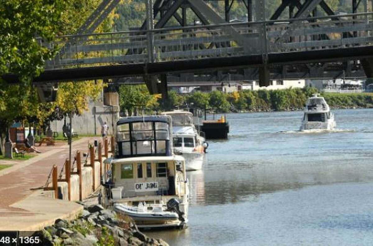 The Erie Canal at Little Falls is reopened. Boats pictured here are at a different spot along the waterway. The Little Falls lock was broken and has been reopened with the help of a crane to operate the device.