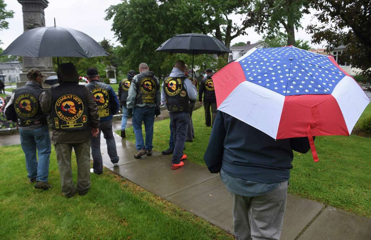 Members of the Combat Veterans Motorcycle Association take part in a Memorial Day wreath laying ceremony on the Milford Green on May 30, 2021.
