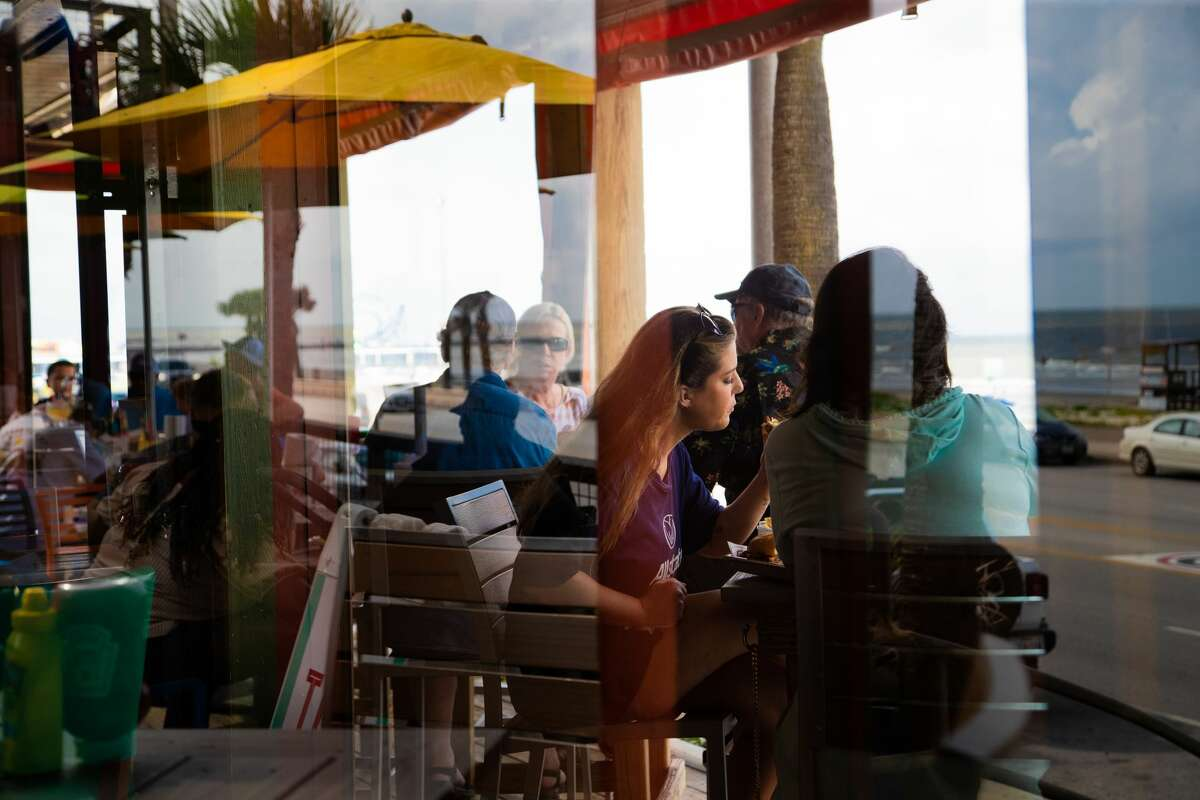 Guests enjoy a meal at The Spot, Thursday, May 27, 2021, in Galveston Island. The restaurant is expecting a busy Memorial Day weekend.