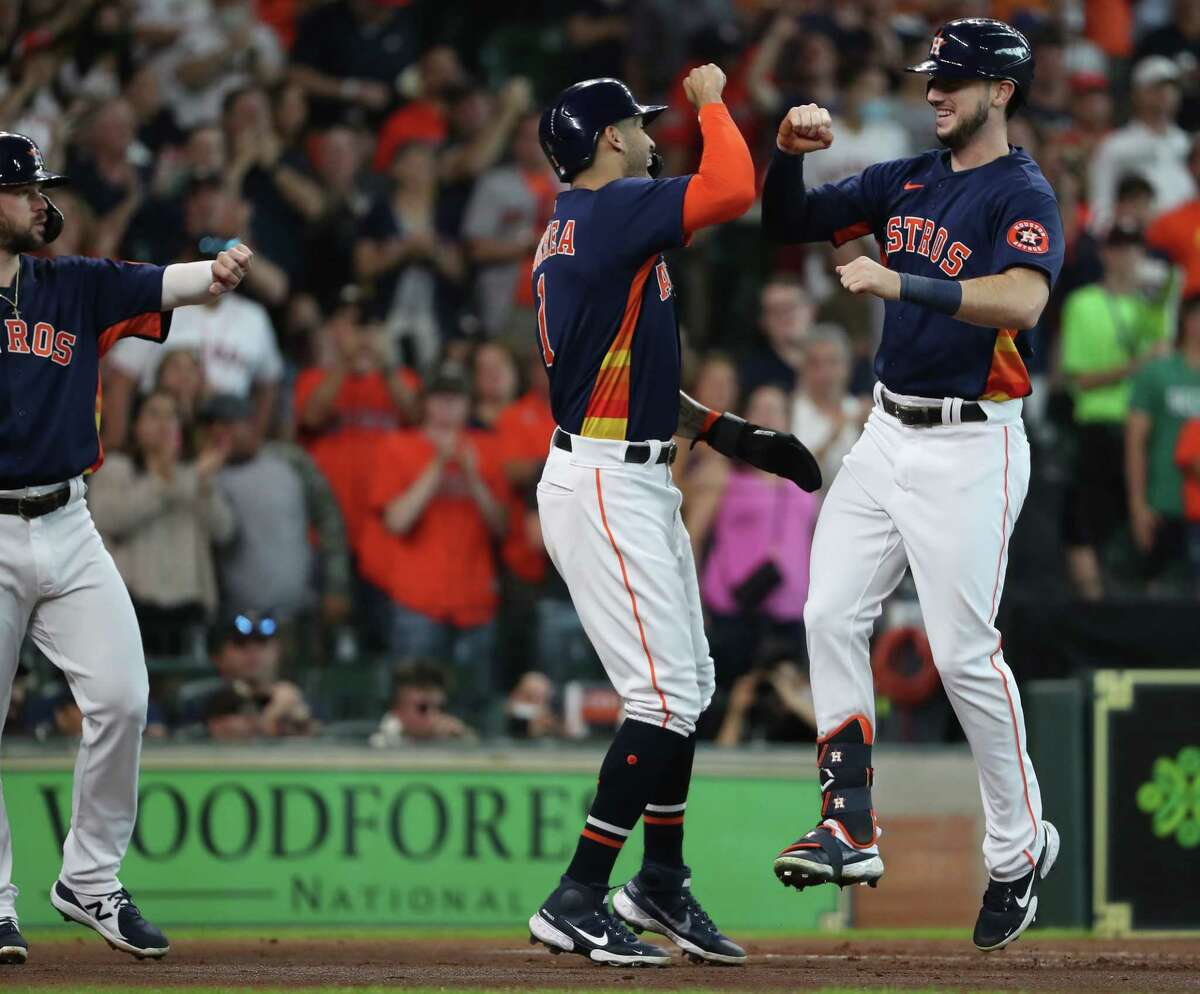Houston Astros shortstop Carlos Correa, left, greets right fielder Kyle Tucker (30) at home after scoring on Tucker's 3-run home run off San Diego Padres starting pitcher Blake Snell during the first inning of a major league baseball game Sunday, May 30, 2021, at Minute Maid Park in Houston.