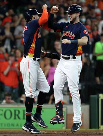 Houston Astros shortstop Carlos Correa, left, greets right fielder Kyle Tucker (30) at home after scoring on Tucker's 3-run home run off San Diego Padres starting pitcher Blake Snell during the first inning of a major league baseball game Sunday, May 30, 2021, at Minute Maid Park in Houston. Photo: Brett Coomer, Staff Photographer / © 2021 Houston Chronicle