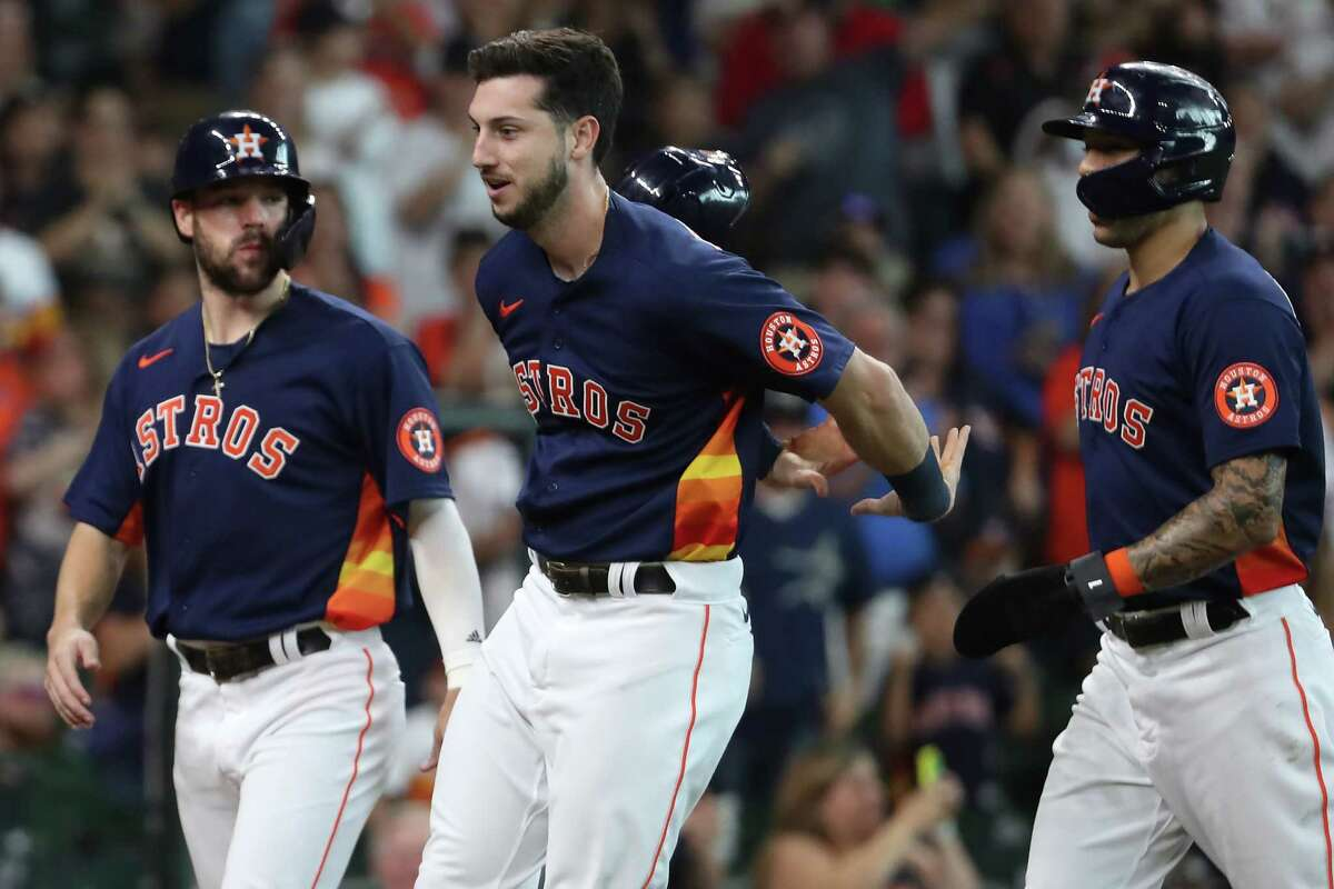 Houston Astros right fielder Kyle Tucker (30) loses his helmet as he crosses home plate after hitting a 3-run home run off San Diego Padres starting pitcher Blake Snell during the first inning of a major league baseball game Sunday, May 30, 2021, at Minute Maid Park in Houston.