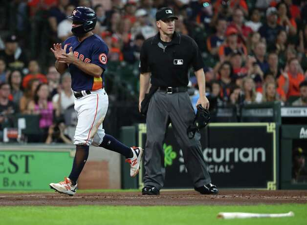Houston Astros second baseman Jose Altuve crosses the plate as he scores on a ground out by Alex Bregman during the first inning of a major league baseball game against the San Diego Padres Sunday, May 30, 2021, at Minute Maid Park in Houston. Photo: Brett Coomer, Staff Photographer / © 2021 Houston Chronicle