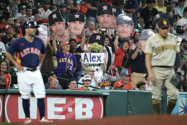 Houston Astros fans hold up Alex Bregman signs as he comes up to bat with Jose Altuve on third base during the first inning of a major league baseball game Sunday, May 30, 2021, at Minute Maid Park in Houston. Photo: Brett Coomer, Staff Photographer / © 2021 Houston Chronicle