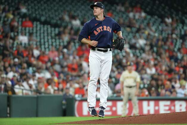 Houston Astros starting pitcher Zack Greinke hops in the air off the mound after throwing a pitch against the San Diego Padres during the first inning of a major league baseball game Sunday, May 30, 2021, at Minute Maid Park in Houston. Photo: Brett Coomer, Staff Photographer / © 2021 Houston Chronicle