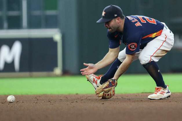 Houston Astros second baseman Jose Altuve picks up a grounder by San Diego Padres first baseman Eric Hosmer to turn an inning-ending double play during the sixth inning of a major league baseball game Sunday, May 30, 2021, at Minute Maid Park in Houston. Photo: Brett Coomer, Staff Photographer / © 2021 Houston Chronicle