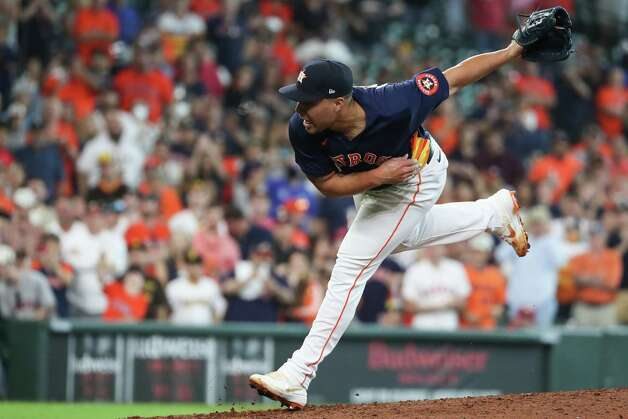 Houston Astros relief pitcher Andre Scrubb follows through on a pitch to San Diego Padres center fielder Jorge Mateo (3), striking him out in the ninth inning of a major league baseball game Sunday, May 30, 2021, at Minute Maid Park in Houston. Photo: Brett Coomer, Staff Photographer / © 2021 Houston Chronicle