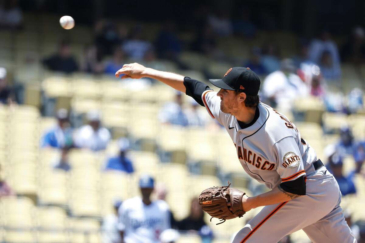 LOS ANGELES, CALIFORNIA - MAY 30: Kevin Gausman #34 of the San Francisco Giants pitches against the Los Angeles Dodgers during the first inning at Dodger Stadium on May 30, 2021 in Los Angeles, California. (Photo by Michael Owens/Getty Images)