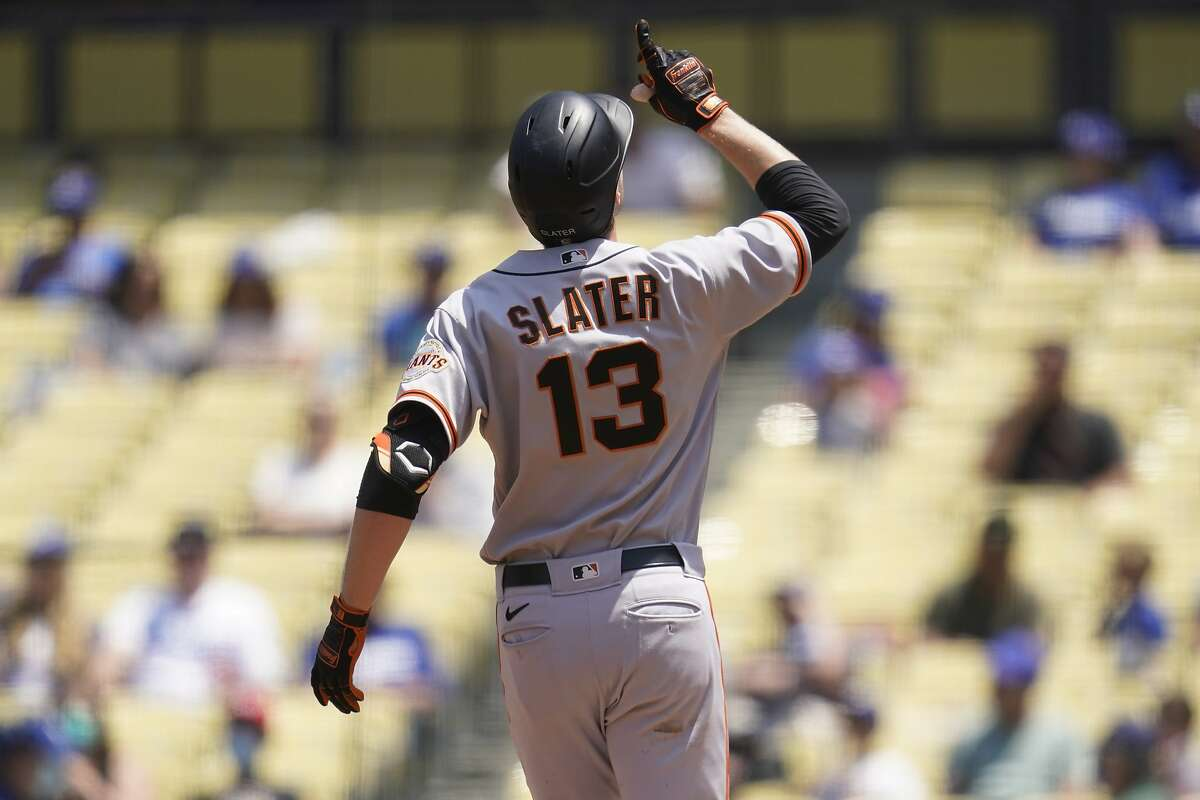 The Giants' Austin Slater celebrates after slugging a home run during the third inning in Los Angeles.