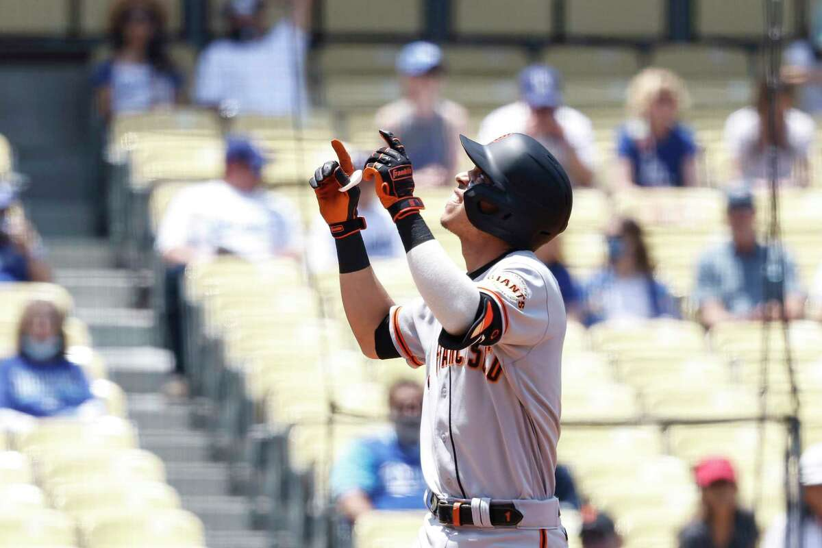 Mauricio Dubon of the San Francisco Giants celebrates after hitting a two-run homer against the Los Angeles Dodgers during the first inning at Dodger Stadium on May 30, 2021 in Los Angeles.