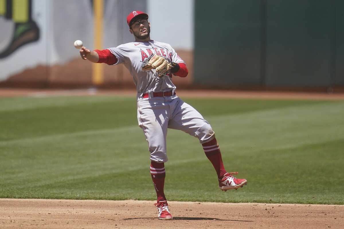 Los Angeles Angels shortstop David Fletcher commits a throwing error that allowed Oakland Athletics' Mark Canha to reach base safely during the third inning of a baseball game in Oakland, Calif., Sunday, May 30, 2021. (AP Photo/Jeff Chiu)