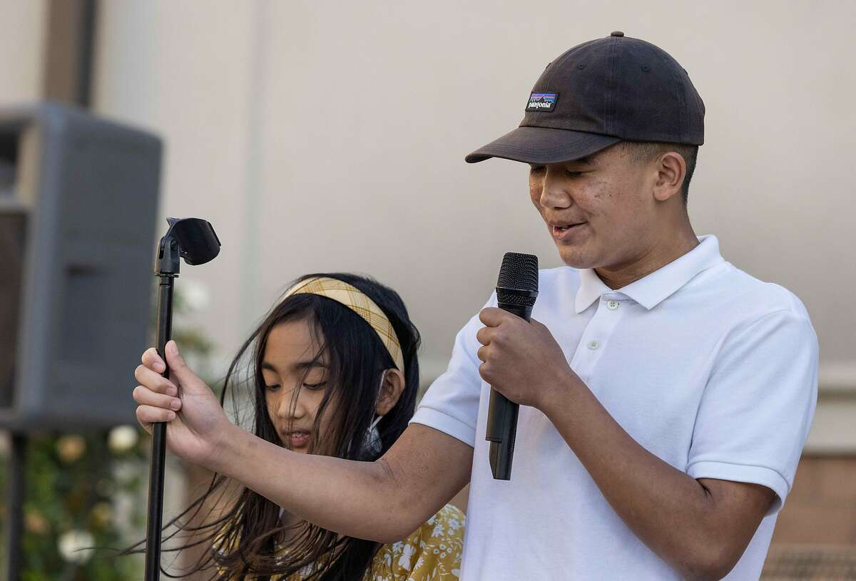 Paul Delacruz Megia's son Galvin, 14, and daughter Avery, 11, speak at a vigil Friday in Mountain House (San Joaquin County) for the victim of the mass shooting at the Valley Transportation Authority light-rail yard in San Jose.