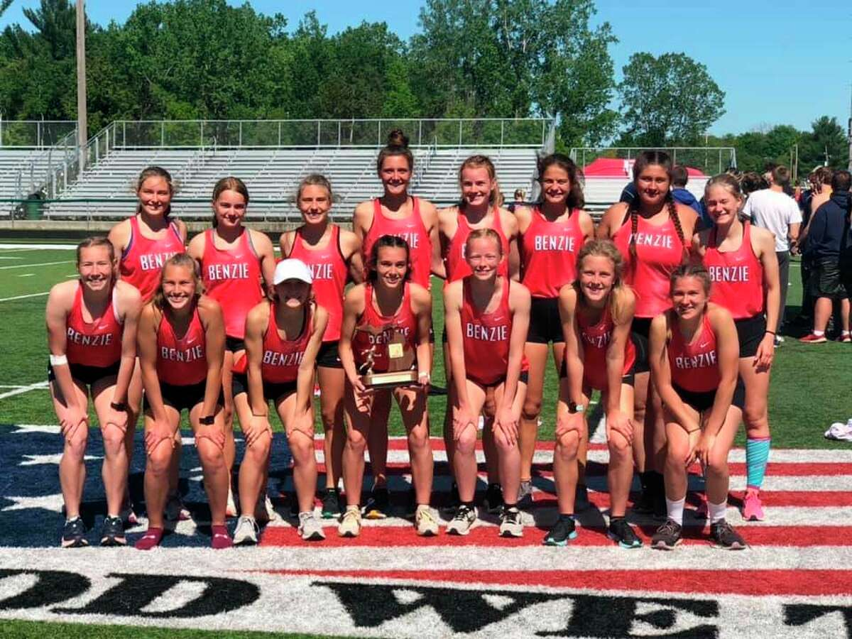Benzie Central's girls track and field team celebrates a state-runner up finish on May 29. (Courtesy photo)