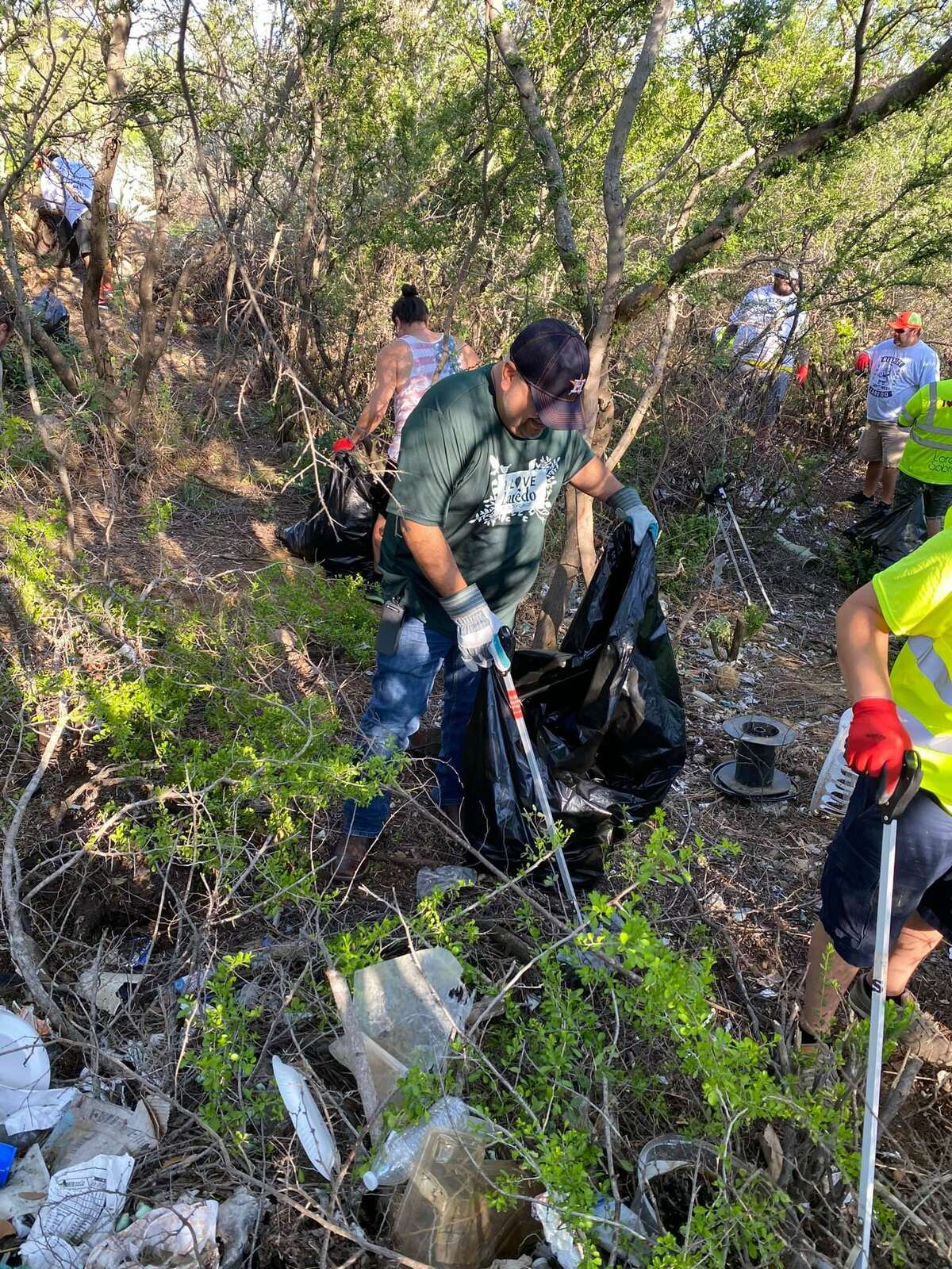 Community volunteers gathered at Robert Muller Park to pick up trash during a District VII clean-up event, Saturday, May 22, 2021.
