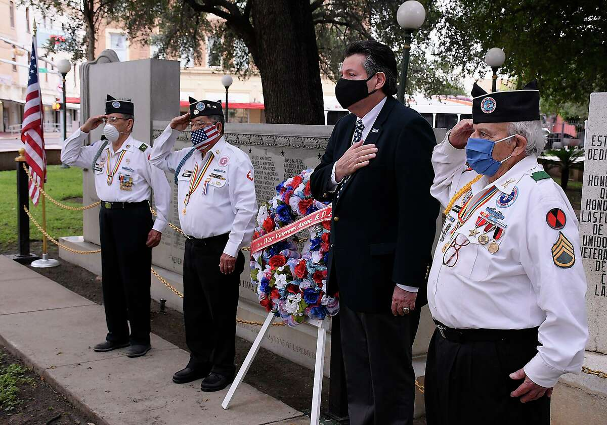 Members of the Korean War Veterans Association invited Mayor Pete Saenz to Laredo's only Memorial Day ceremony at Jarvis Memorial Plaza on May 25, 2020. Association members participating in the laying of a wreath and roses by the memorial for Laredoans lost in action during the war, were, Ernesto Sanchez, Nicolas Nañez and Salvador Sciaraffa.