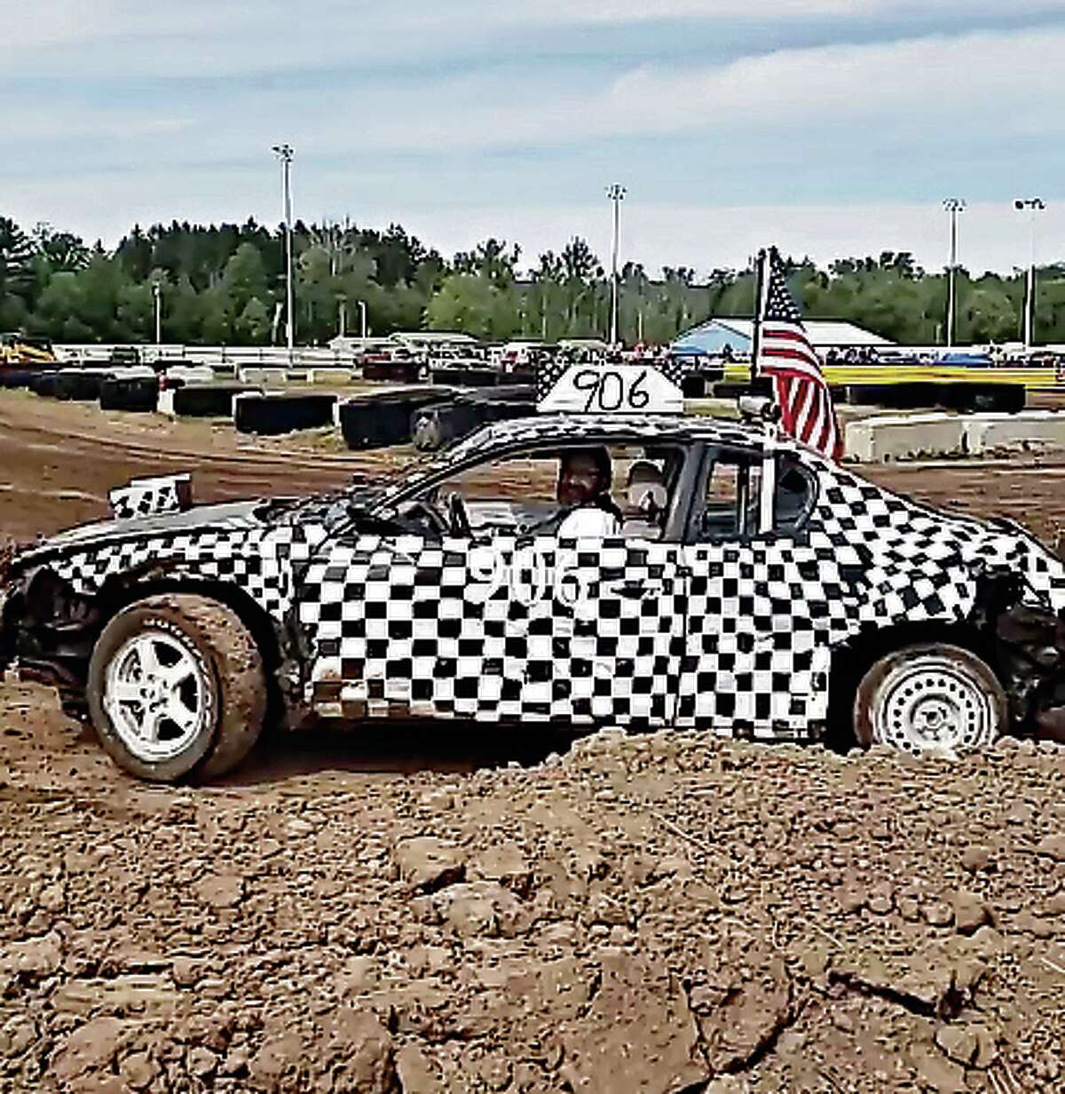 Pastor Jamie Parlette, of First Baptist Church in Bear Lake, conducted the blessing on Sunday afternoon and tested out the track at the Manistee County Fairgrounds in vehicle Number 906 during a Facebook live video from the event.