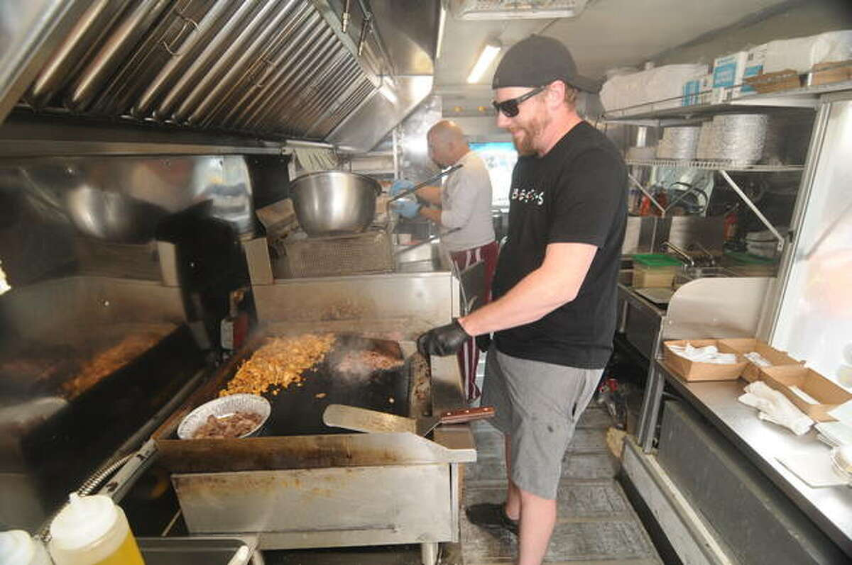 Mike Roos of Sedara Sweets and Ice Cream prepares street tacos during the Wood River Food Truck Festival.