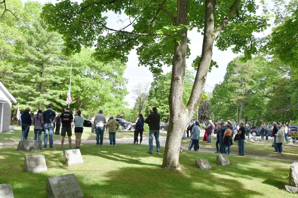 About 50 people attended the United Veterans Council of Manistee County Memorial Day ceremonies took place at Trinity Cemetery and Oak Grove Cemetery on Monday morning. (Arielle Breen/News Advocate)