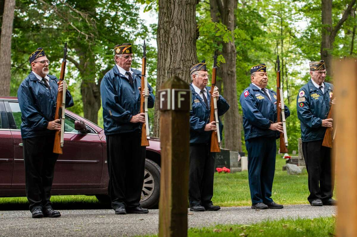 Veterans perform a 21-gun salute during a ceremony on Memorial Day, May 31, 2021 at the Midland Municipal Cemetery.