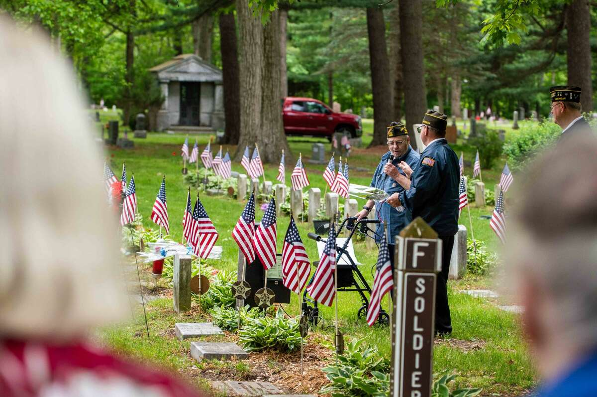 Veteran Joe DuFort (left) helps honor fallen soldiers during a ceremony on Memorial Day, May 31, 2021 at the Midland Municipal Cemetery.