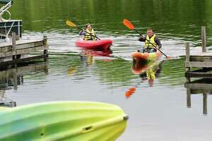 James Reeser and his girlfriend Shannon Vigh of Latham make their way back to the Kayak Shak at the Fish Creek Marina after enjoying a Memorial Day paddle with the rented kayaks on Monday, May 31, 2021 in Saratoga Springs, N.Y. (Lori Van Buren/Times Union)