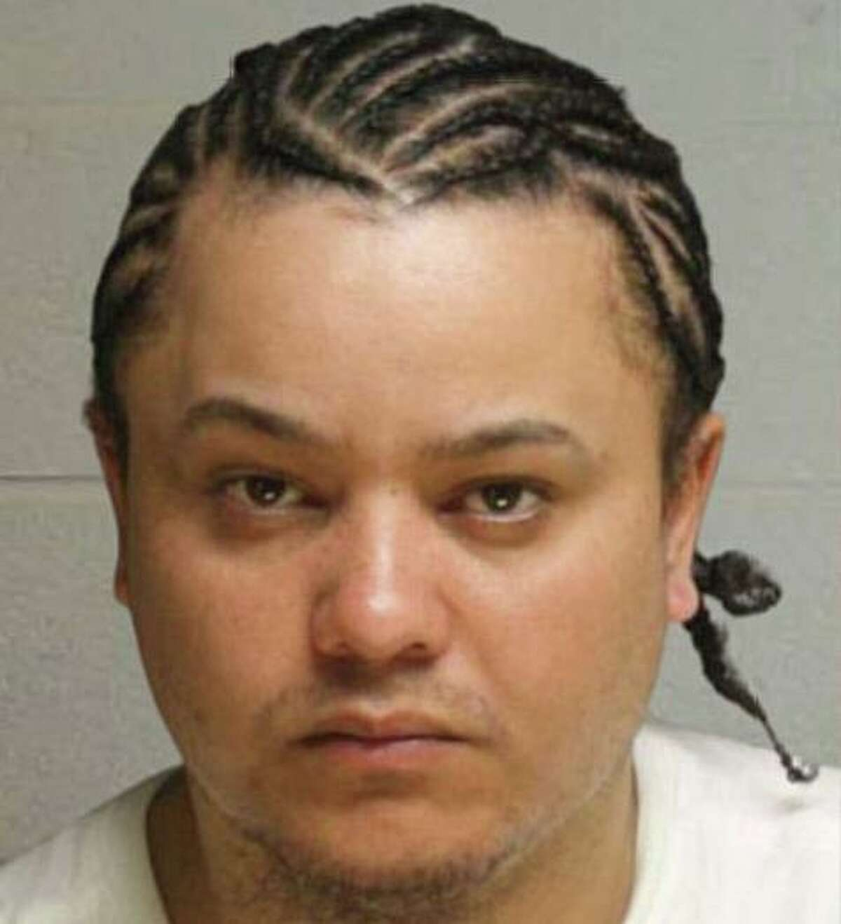 Carlos Reyes-Pagan, 35, remains at large, but Waterbury, Conn., police have an outstanding warrant charging him with murder and first-degree robbery. Police said he has an address on Southampton Street in Boston, Mass., but is known to frequent many cities and towns throughout Massachusetts and Connecticut. He is considered armed and dangerous, police said.