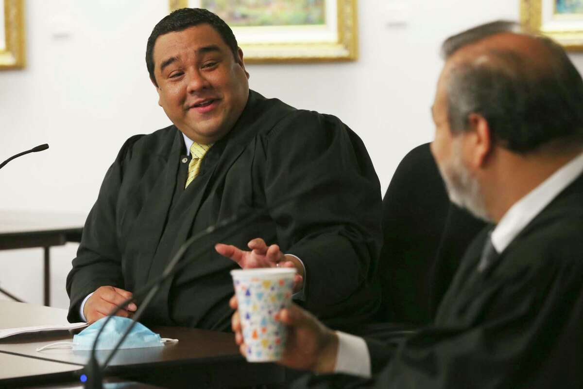 Juvenile District Judge Carlos Quezada, left, talks with state District Judge Ron Rangel while they work with a pool of prospective jurors Friday. Quezada used to be a clerk in the Central Jury Room before attending law school.
