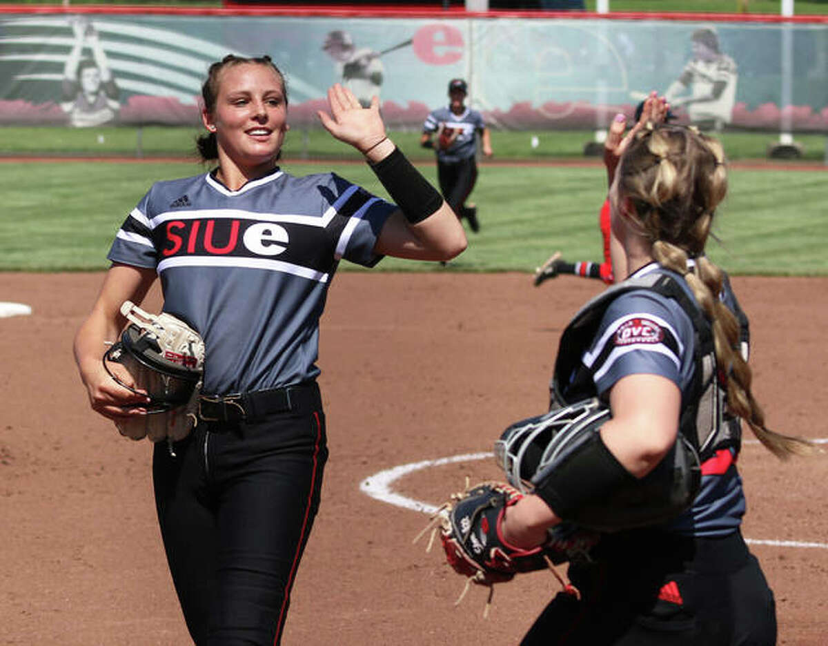 SIUE pitcher Sydney Baalman (left), a freshman from Hardin, gets a high-five from catcher Amber Storer after ending an inning with strikeout during a Cougars' 3-2 win over Austin Peay on April 25 at Cougar Field in Edwardsville.