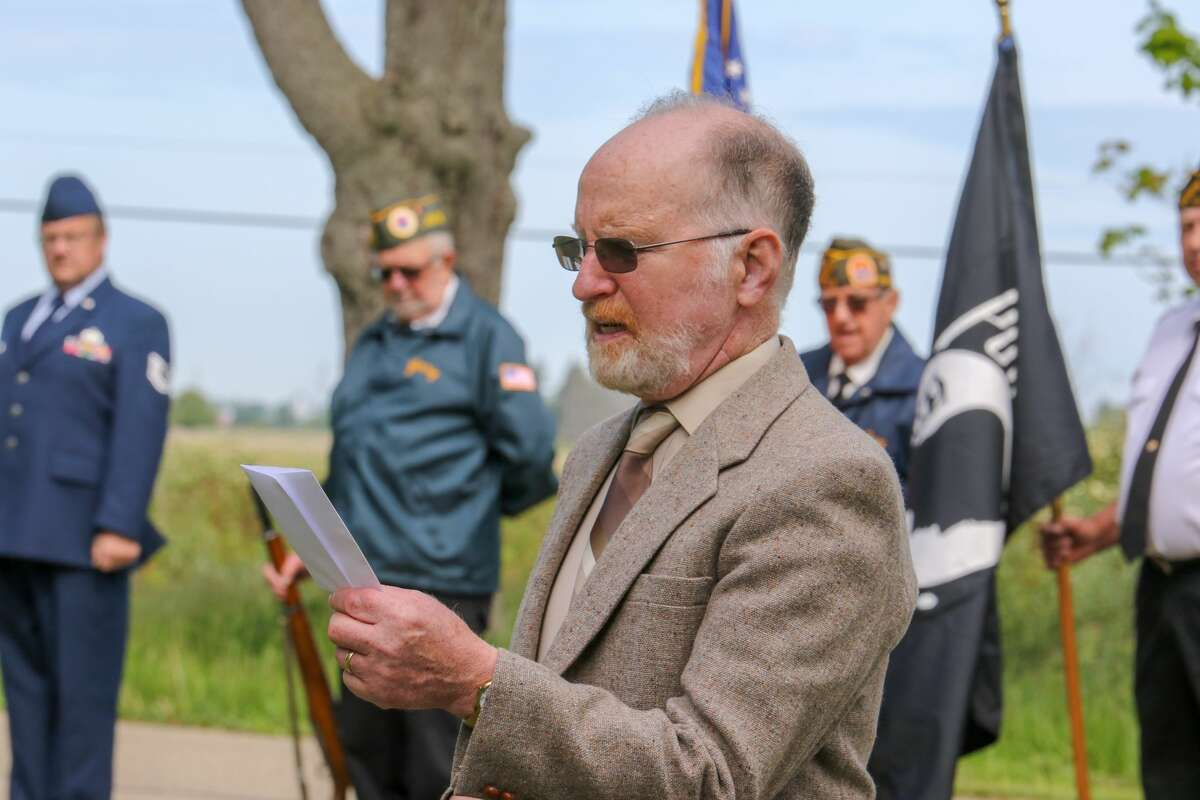 Port Hope residents participate in a Memorial Day ceremony.