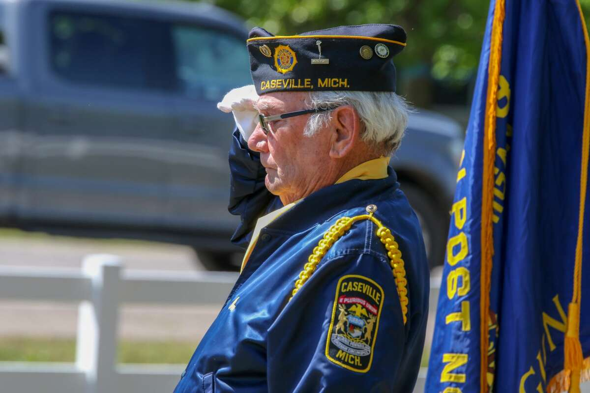 Veterans perform a Memorial Day service at the cemetery in Caseville Monday morning as area residents and visitors look on.