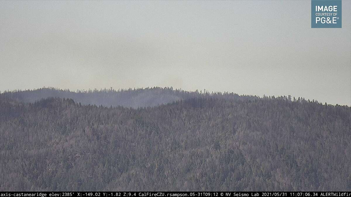 Smoke rises from the Grade Fire on Sunday, May 31, at 11:10 a.m. in this image from the Alert Wildfire Network's Castanea Ridge remote camera in the Santa Cruz Mountains.