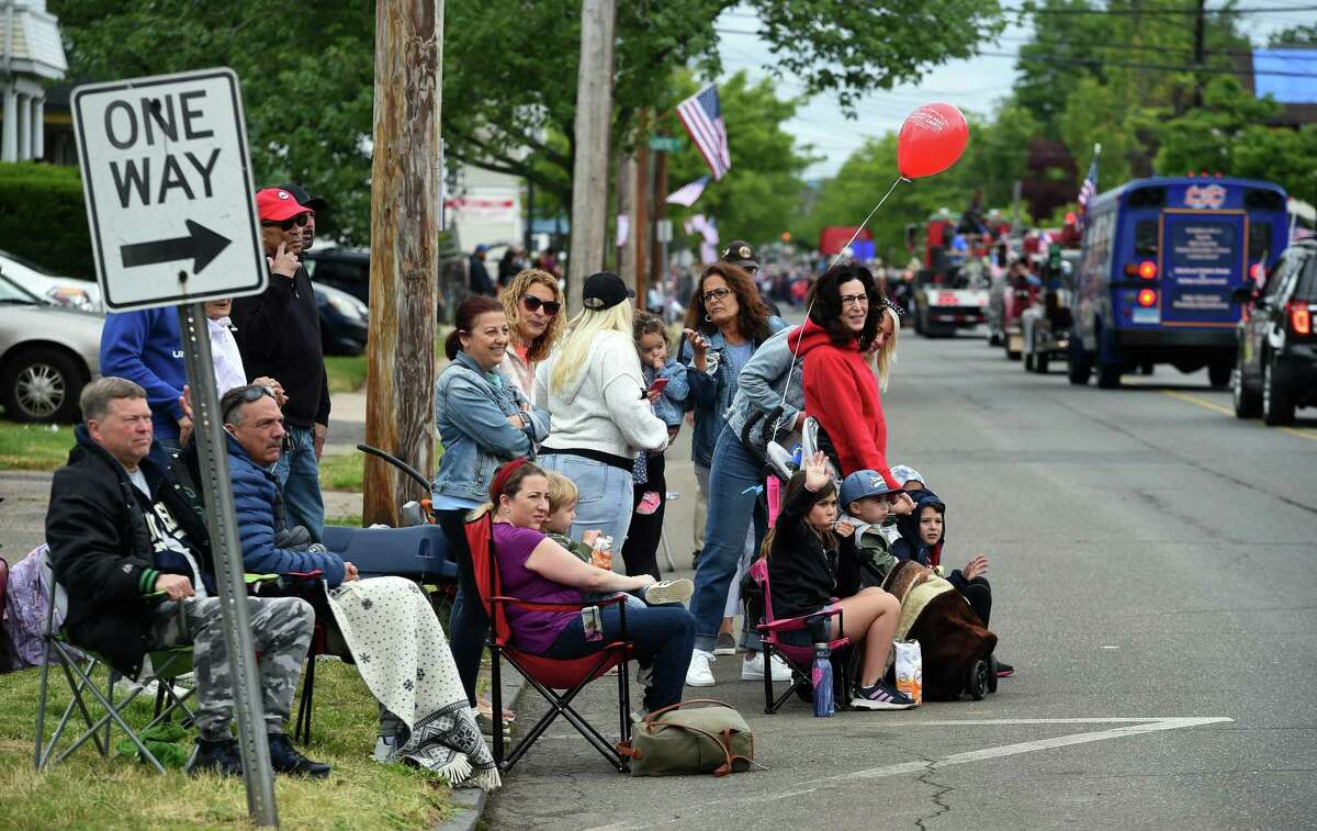 People watch a Memorial Day Parade as it travels up Campbell Avenue in West Haven toward the center of town on May 31, 2021.