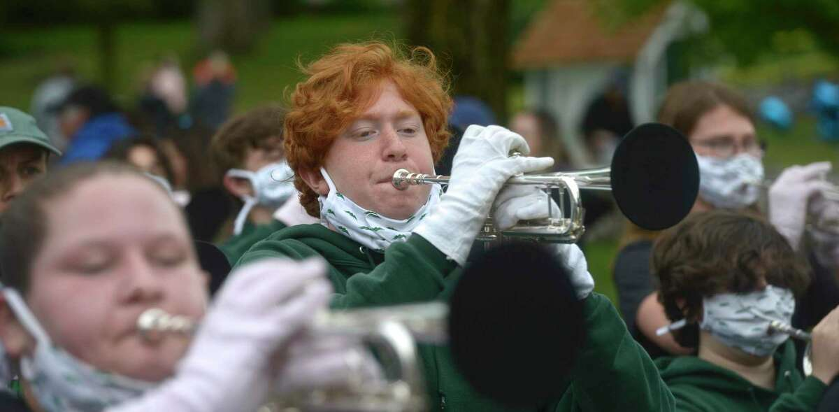 Bryce Lewis, 16, plays trumpet with the New Milford High School Marching Band as they take part in the Memorial Day parade in New Milford, Conn, Monday, May 31, 2021. Addressing the crowd, she said,