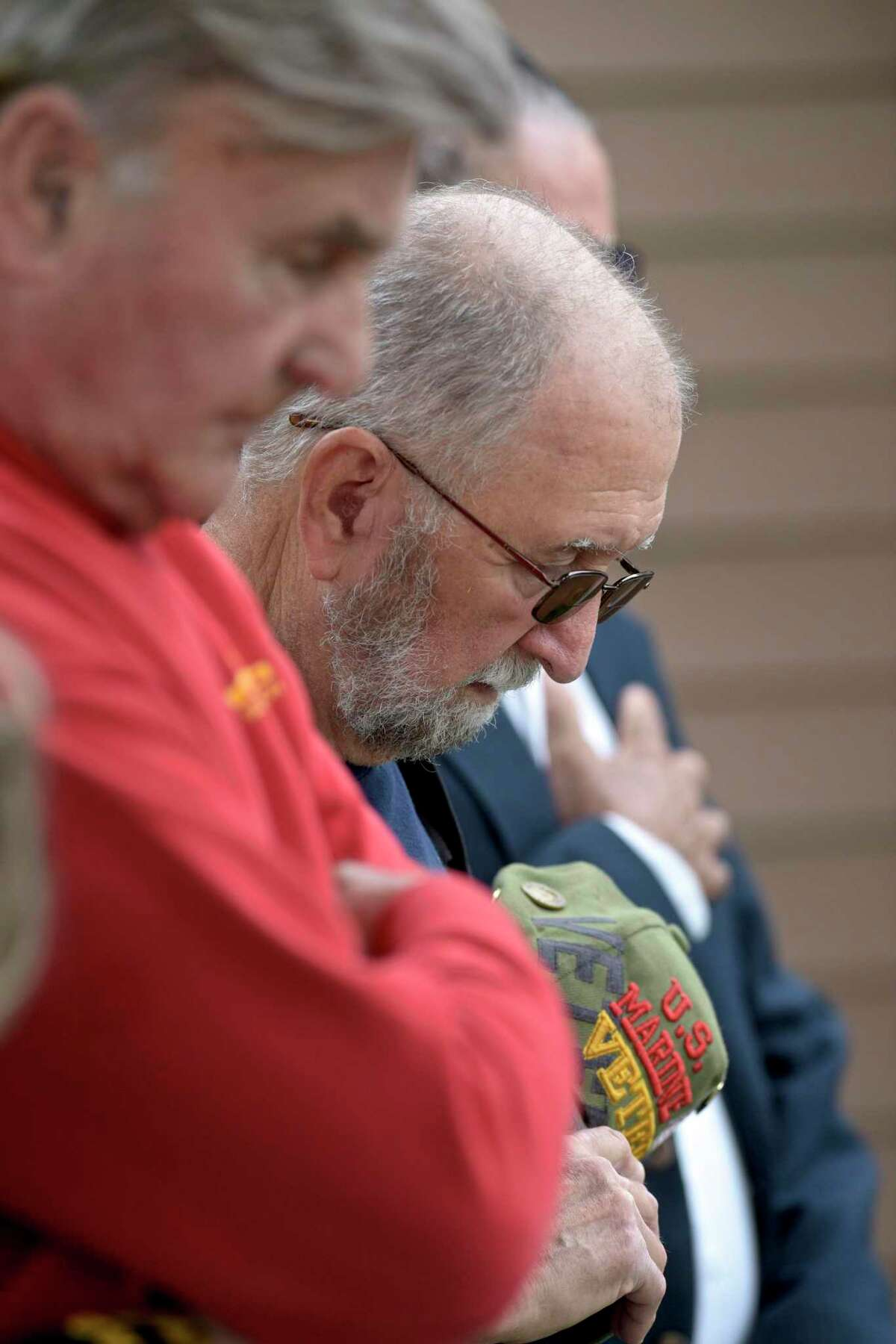 Veteran Richard Godfrey, of Bethel, lowers his head during a moment of slience during a Memorial Day ceremony at VFW Post 149 in Danbury, Conn, on Monday, May 31, 2021. Godfrey is a member of the post.