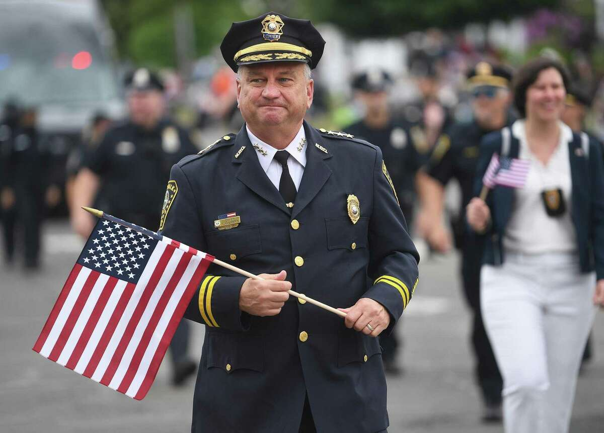 Norwalk Police Chief Thomas Kulhawik marches in the city's annual Memorial Day parade on East Avenue in Norwalk, Conn. on Monday, May 31, 2021.