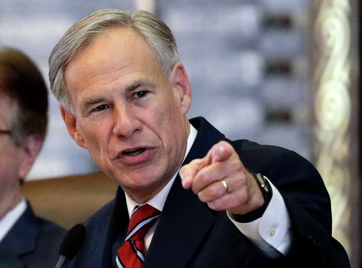 FILE - In this Feb. 5, 2019, file photo, Texas Gov. Greg Abbott gives his State of the State Address in the House Chamber in Austin, Texas. Texas lawmakers have given final approval to allowing people carry handguns without a license, and the background check and training that go with it. The Republican-dominated Legislature approved the measure Monday, May 24, 2021 sending it to Gov. Abbott. (AP Photo/Eric Gay, File)