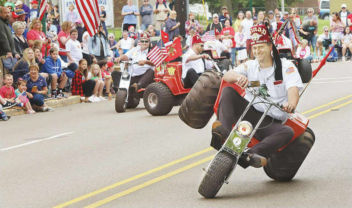 It couldn't be an Alton Memorial Day Parade without the crowd pleasing Ainad Rolling Nobles on their three-wheelers. While COVID-19 concerns limited last year's parade to a small covert gathering, people were out in large numbers Monday for this year's event.