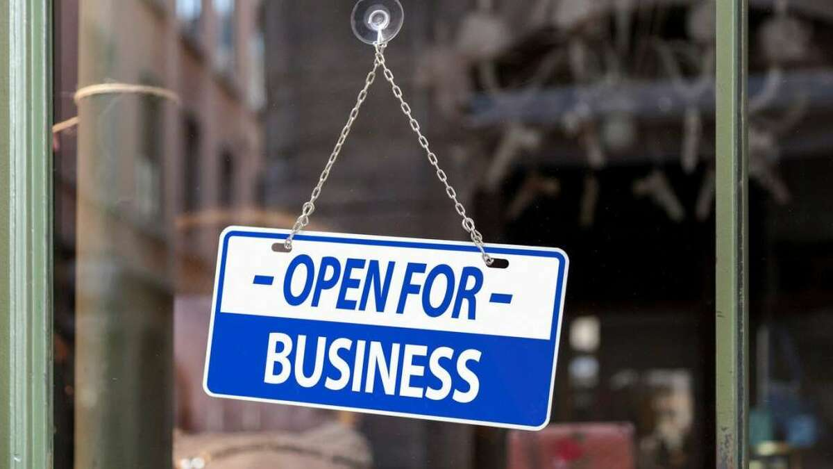 An open for business sign welcomes passing customers.