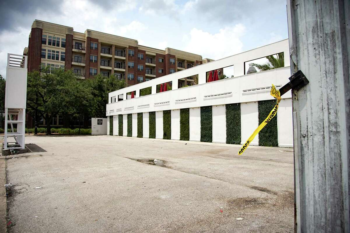 Police tape remains around Clé nightclub, following a shooting early this morning that left two dead and two injured in Houston on Monday, May 31, 2021.