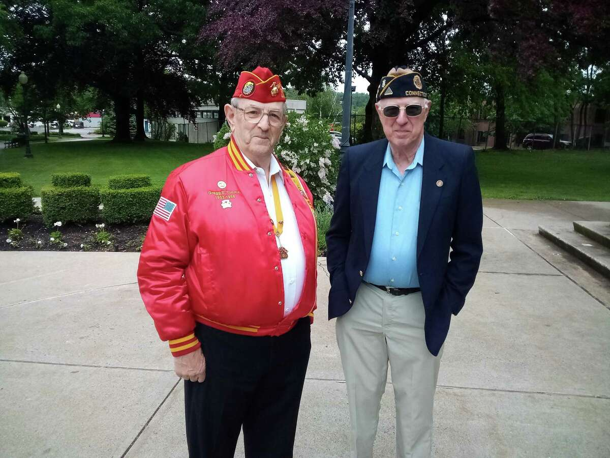 Torrington held its Memorial Day observance Monday with a short parade and ceremonies at the Coe Memorial Park Civic Center lawn. Above are veterans George Timms and Joe Pathe, American Legion Post 38, Torrington.