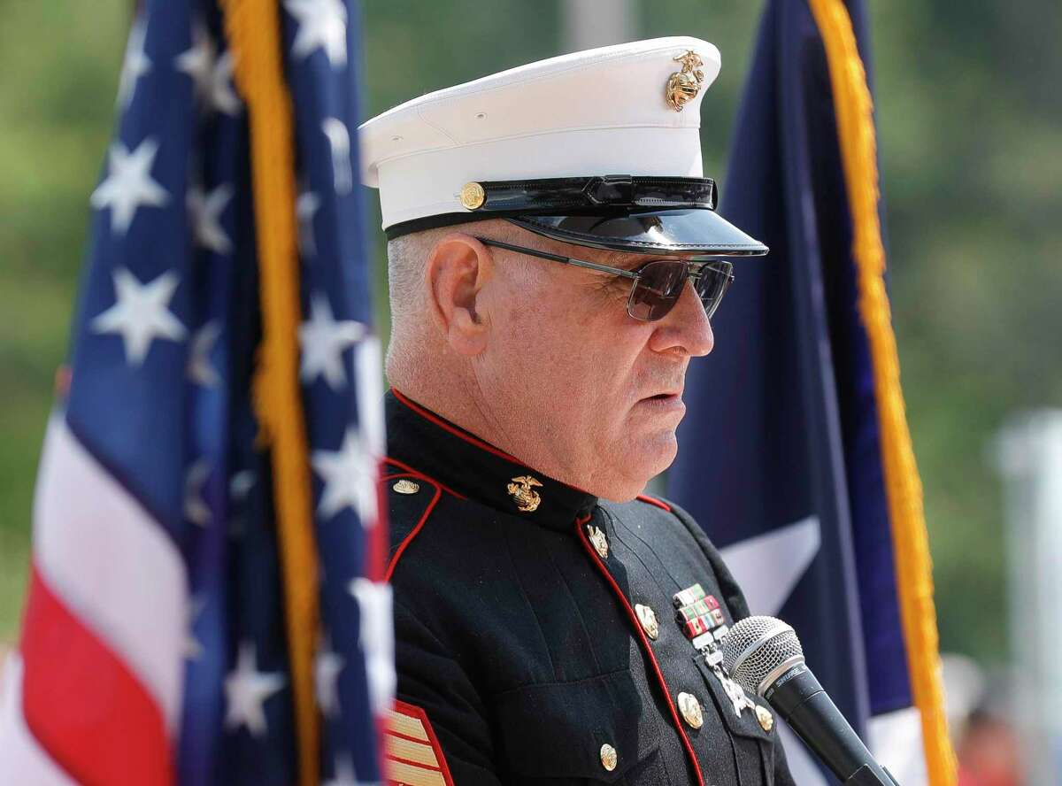 MSgt US Marines Retired Brian Hampton speaks at a Memorial Day ceremony at the Montgomery County Veteran's Memorial Park on Monday in Conroe.