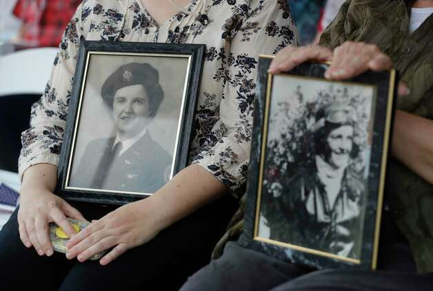 Mary Hailey, right, holds an image of her mother-in-law who served as a pilot with Women Air Force Service Pilots beside her daughter, Dawn, during a Memorial Day ceremony at the Montgomery County Veteran's Memorial Park, Monday, May 31, 2021, in Conroe. WASP was a Air Force program that tasked some 1,100 civilian women with noncombat military flight duties during World War II, making them the first women to fly U.S. military aircraft. Photo: Jason Fochtman, Houston Chronicle / Staff Photographer / 2021 © Houston Chronicle