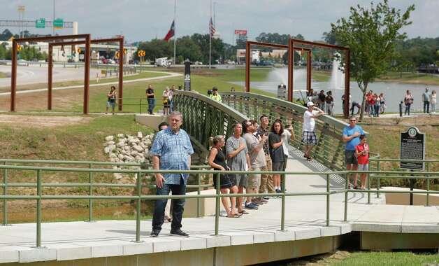 Visitors walk through the Montgomery County Veteran's Memorial Park on Memorial Day Photo: Jason Fochtman, Houston Chronicle / Staff Photographer / 2021 © Houston Chronicle