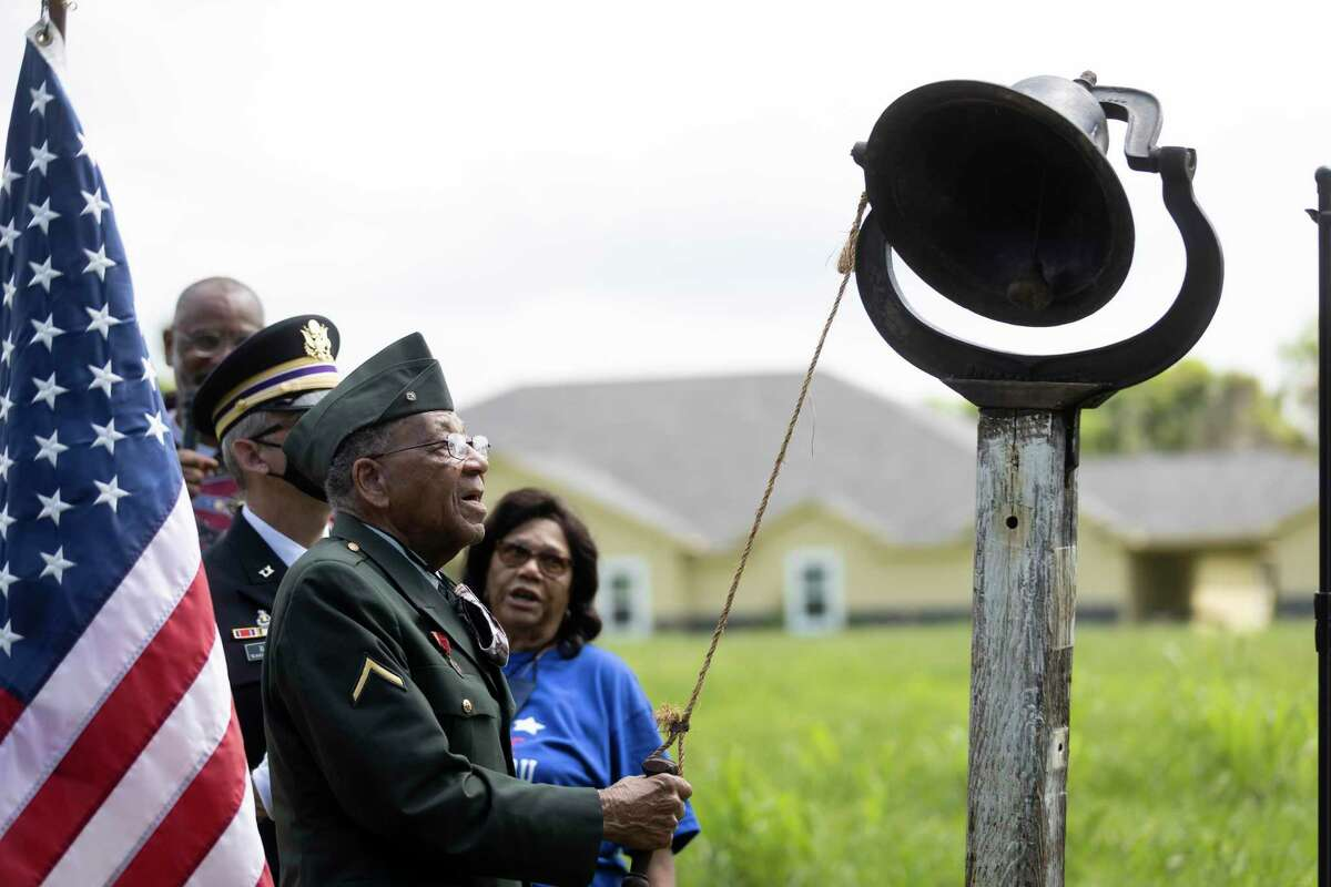 Pfc. Romie Hollins rings the bell during the 4th Annual Memorial Day Celebration at the Sweet Rest Cemetery, Monday, May 31, 2021, in Tamina. The cemetery was officially designated as a historical area after a nine-month long process led by the The Tamina Cemetery and Community Project CDC.