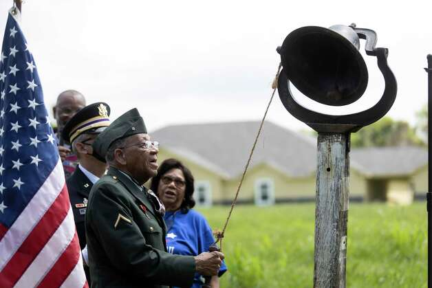Pfc. Romie Hollins rings the bell during the 4th Annual Memorial Day Celebration at the Sweet Rest Cemetery, Monday, May 31, 2021, in Tamina. The cemetery was officially designated as a historical area after a nine-month long process led by the The Tamina Cemetery and Community Project CDC. Photo: Gustavo Huerta, Houston Chronicle / Staff Photographer / Houston Chronicle © 2021