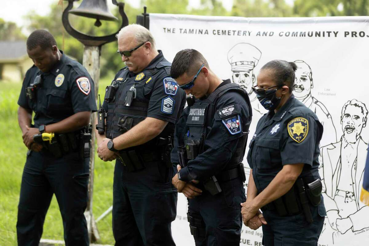 Montgomery County Constable Precinct 3 officers bow their head for a moment of silence during the 4th Annual Memorial Day Celebration at the Sweet Rest Cemetery, Monday, May 31, 2021, in Tamina. The cemetery was officially designated as a historical area after a nine-month long process led by the The Tamina Cemetery and Community Project CDC.