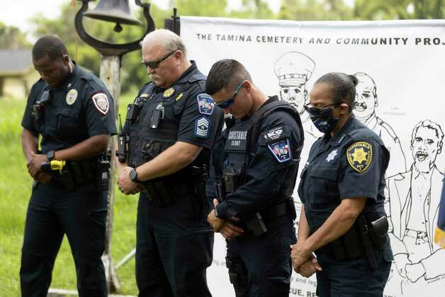 Montgomery County Constable Precinct 3 officers bow their head for a moment of silence during the 4th Annual Memorial Day Celebration at the Sweet Rest Cemetery, Monday, May 31, 2021, in Tamina. The cemetery was officially designated as a historical area after a nine-month long process led by the The Tamina Cemetery and Community Project CDC. Photo: Gustavo Huerta, Houston Chronicle / Staff Photographer / Houston Chronicle © 2021